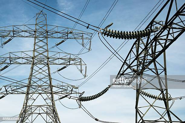 pylons and power lines near to major electricity substation - power line stock pictures, royalty-free photos & images
