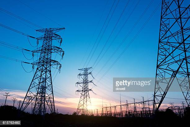 pylons near power transform station at sunrise - power line stock pictures, royalty-free photos & images