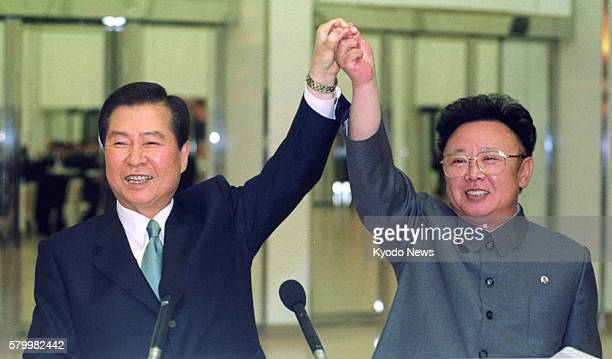 Pyongyang, North Korea - File photo taken in June 2000 shows South Korean President Kim Dae Jung and North Korean leader Kim Jong Il holding hands...