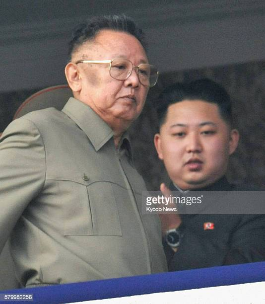 Pyongyang, North Korea - North Korean leader Kim Jong Il walks off after reviewing a military parade marking the 65th anniversary of the founding of...