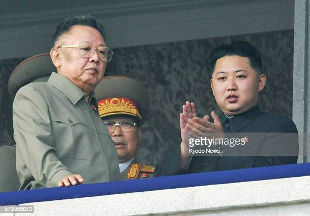 Pyongyang, North Korea - Photo taken on Oct. 10 shows North Korean leader Kim Jong Il and Kim Jong Un , a son of Jong Il, reviewing a military parade...