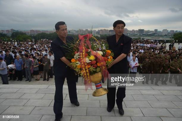 Pyongyangites visit the statues of presidents Kim Il Sung and Kim Jong Il on Mansu Hill on the 23rd anniversary of Kim Il Sung's demise in Pyongyang...