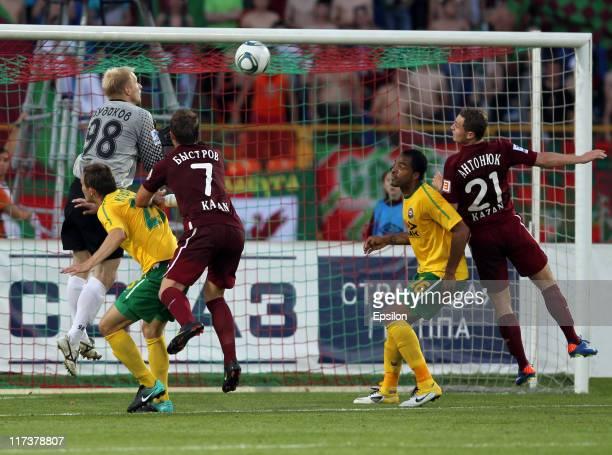 Pyotr Bystrov and Alexandru Antoniuc of FC Rubin Kazan battles for the ball with Aleksandr Budakov Aleksei Kozlov and Zelao of FC Kuban Krasnodar...