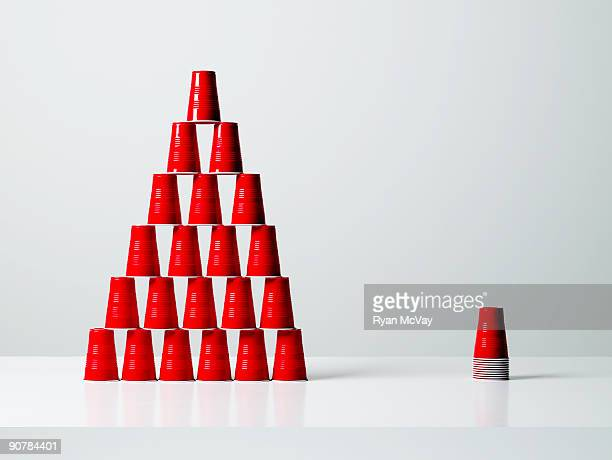 pyramid and stack of red plastic cups.
