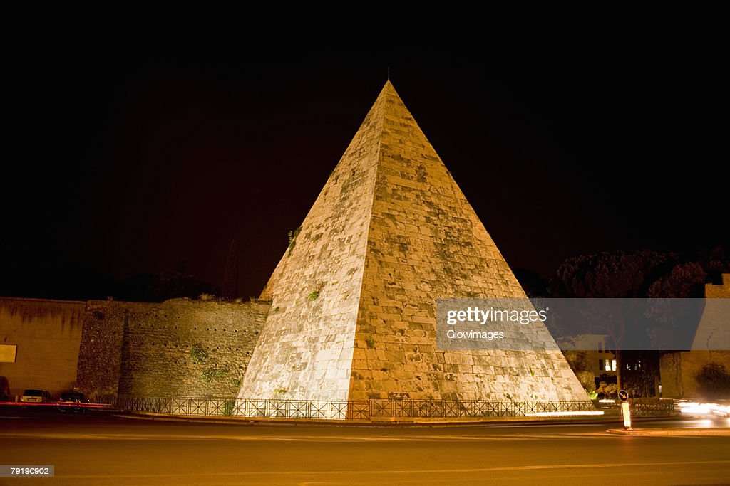 Pyramid lit up at night, Pyramid of Cestius, Rome, Italy : Stock Photo