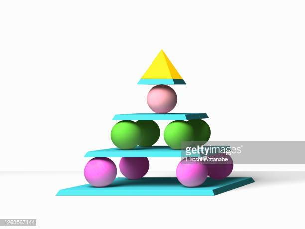 a pyramid of balanced, colorful, geometric shapes - 黄緑色 ストックフォトと画像