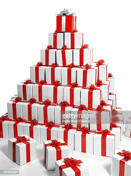 Pyramid of gift boxes with one red at the top