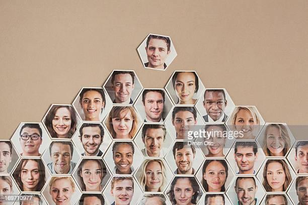 Pyramid of hexagonal portraits, one landing on top