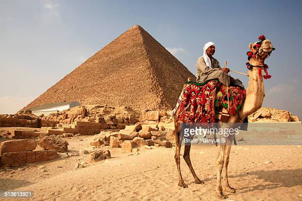 Pyramid of Khufu with a man on camel