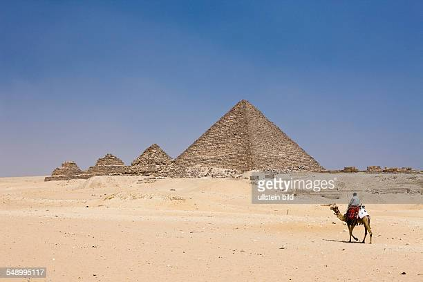 Pyramid of Menkaure and three small Pyramids of Queens Cairo Egypt