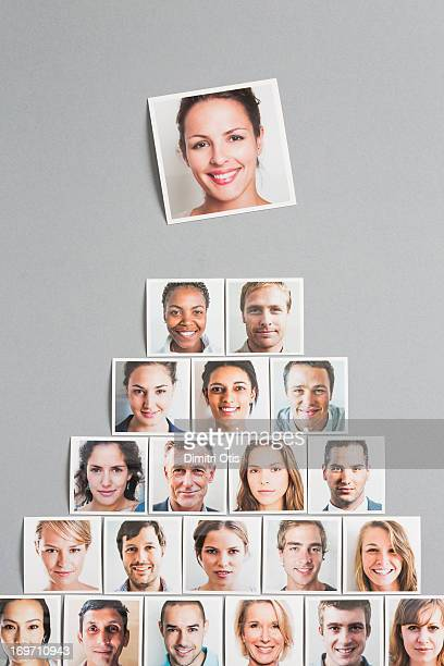 Pyramid of portrait prints, one of woman on top