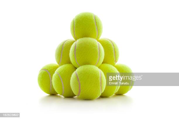 a pyramid of tennis balls - tennis ball stock pictures, royalty-free photos & images