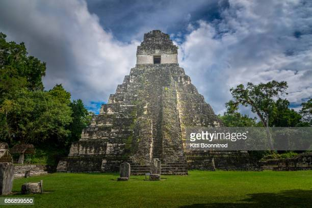 pyramid of tikal, a famous mayan site in guatemala - pyramid stock pictures, royalty-free photos & images