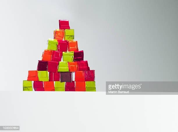 pyramid of vibrant gelatin dessert cubes - gelatin dessert stock photos and pictures