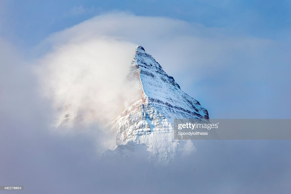 Pyramid Shaped Mount Assiniboine in the Fog : Stock Photo