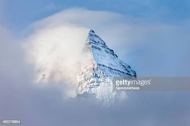 pyramid shaped mount assiniboine in the fog - mountain peak stock pictures, royalty-free photos & images