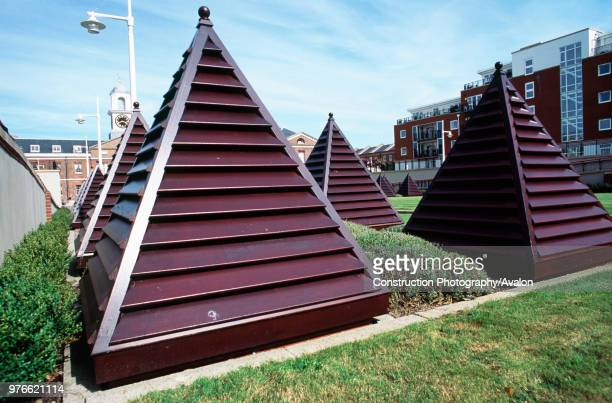 Pyramid shapes for ventilation vents on the central grass courtyard between apartments in Old Portsmouth Hampshire UK
