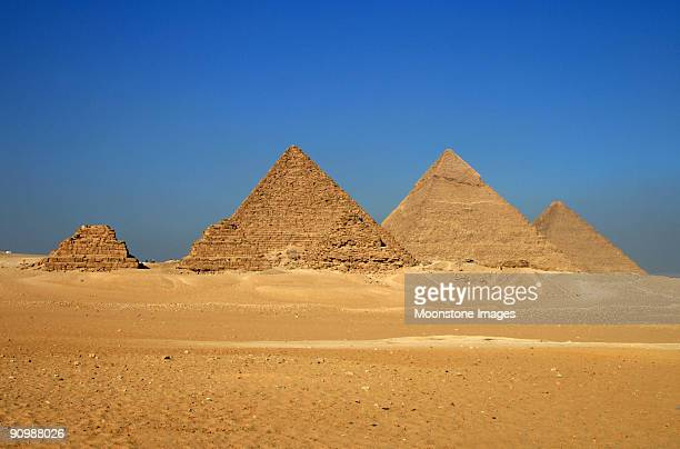 pyramids in giza in the desert - giza pyramids stock pictures, royalty-free photos & images