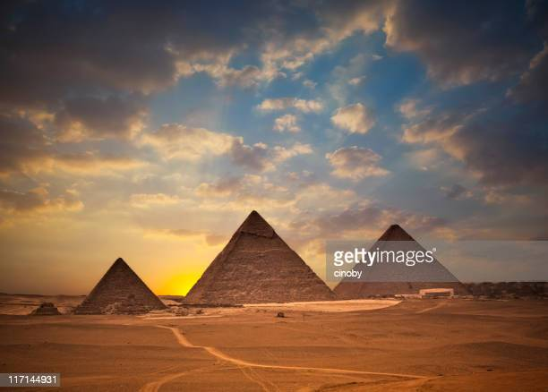 pyramids of giza at sunset - giza pyramids stock pictures, royalty-free photos & images