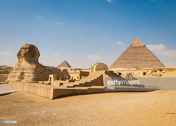 pyramids of giza with sphinx in foreground - giza pyramids stock pictures, royalty-free photos & images