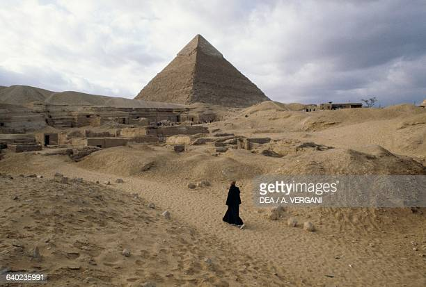 Pyramids of Khafre and Cheops a man in the foreground a Giza Necropolis Egyptian Civilisation Old Kingdom Dynasty IV