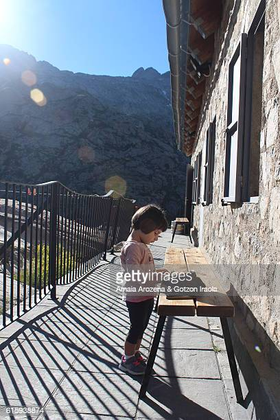 Pyrenees, Huesca province. A little girl in a mountain hut of Pyrenees