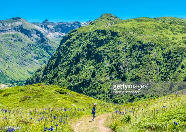 pyrenees national park, hautes-pyrenees, child in the cirque d'estaube (unesco world heritage) - hautes pyrenees stock pictures, royalty-free photos & images