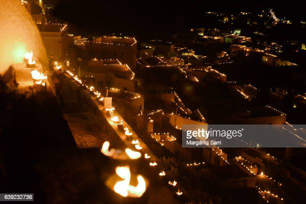 Pyrgos, a village in Santorini island illuminated during Easter by 10000 cans lit with fire