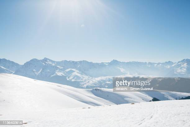 pyrénées mountain range with snow and blue sky - バニエールドルション ストックフォトと画像