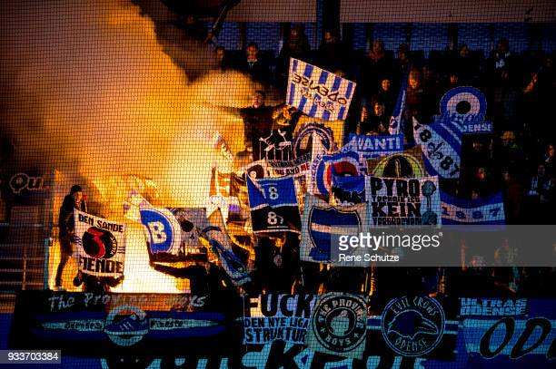 Pyro between OB fans Action from the Danish Alka Superliga match between Randers FC and OB Odense at BioNutria Park on March 18 2018 in Randers...