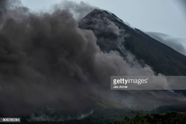 Pyroclastic cloud is being spewed by lava emissions of Mayon volcano on January 17 2018 in Camalig Albay in the Philippines Thousands evacuate as...