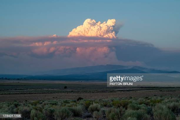 Pyrocumulus cloud from the Bootleg Fire drifts into the air near Bly, Oregon on July 16, 2021. - The extreme drought-hit western United States braced...