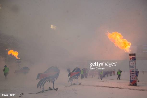 Pyrotechnics erupt flames during pregame ceremonies before the game between the Buffalo Bills and the Indianapolis Colts at New Era Field on December...