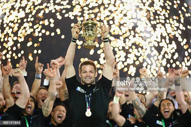 Pyrotechnics explode as Richie McCaw of the New Zealand All Blacks lifts the Webb Ellis Cup following the victory against Australia in the 2015 Rugby...