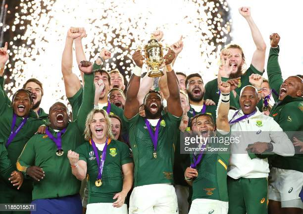Pyrotechnics explode as Siya Kolisi of South Africa lifts the Webb Ellis Cup following his team's victory against England in the Rugby World Cup 2019...