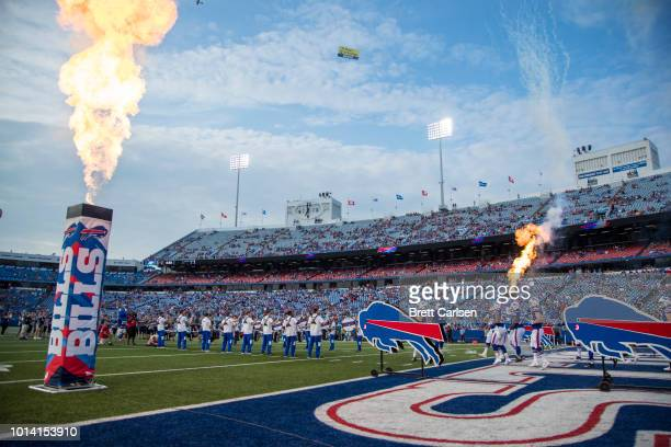 Pyrotechnics explode as the Buffalo Bills enter the field before a preseason game against the Carolina Panthers at New Era Field on August 9, 2018 in...