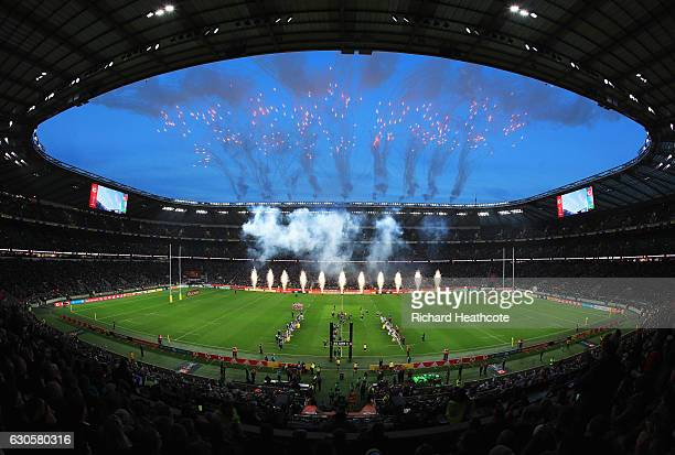 Pyrotechnics explode as the teams run onto the pitch prior to the Aviva Premiership Big Game 9 match between Harlequins and Gloucester Rugby at...