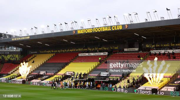 Pyrotechnics go off inside the ground to celebrate Watford's promotion back to the Premier League as both teams walk out prior during the Sky Bet...