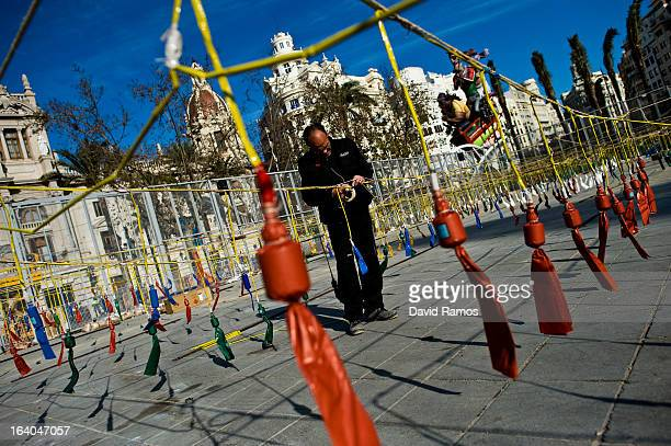 Pyrothecnic employee sets up explosives prior to the 19th 'Mascleta', an explosive barrage of firecrackers and fireworks celebrating the arrival of...