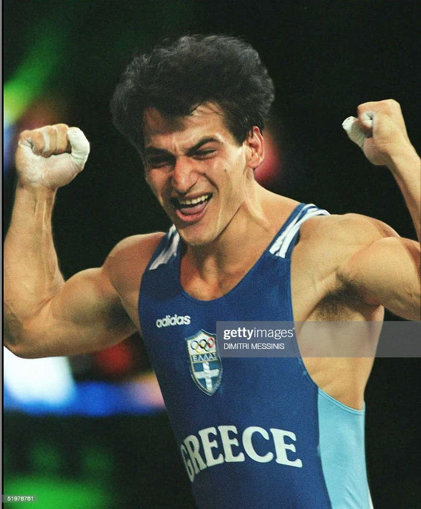 Pyrros Dimas of Greece celebrates his new world record and ...