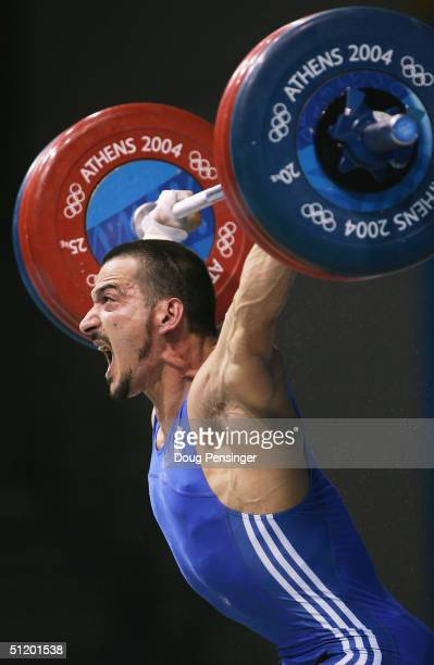 Pyrros Dimas of Greece shouts out as he completes a lift in the men's 85 kg category weightlifting competition on August 21 2004 during the Athens...