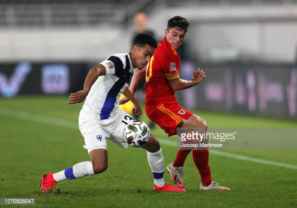 Pyry Soiri of Finland battles for possession with Daniel James of Wales during the UEFA Nations League group stage match between Finland and Wales at...