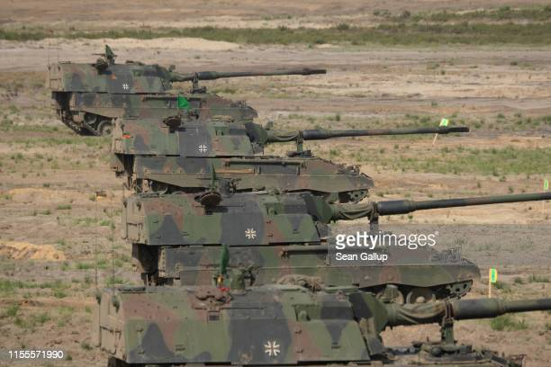PzH 2000 Howitzers of the Bundeswehr the German armed forces take part in the NATO Noble Jump military exercises during a live fire demonstration on...