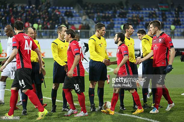 Qabala's team shakes the hand of the match referee before the Europa League group C soccer match between Qabala FK and FC Krasnodar at the Bakcell...