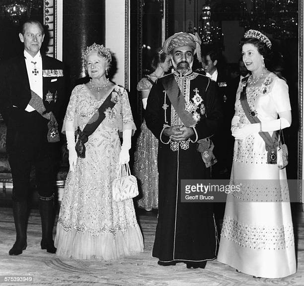 Qaboos Bin Said Al Said , the Sultan of Muscat and Oman, with Queen Elizabeth II , the Queen Mother and the Duke of Edinburgh, at a banquet held in...