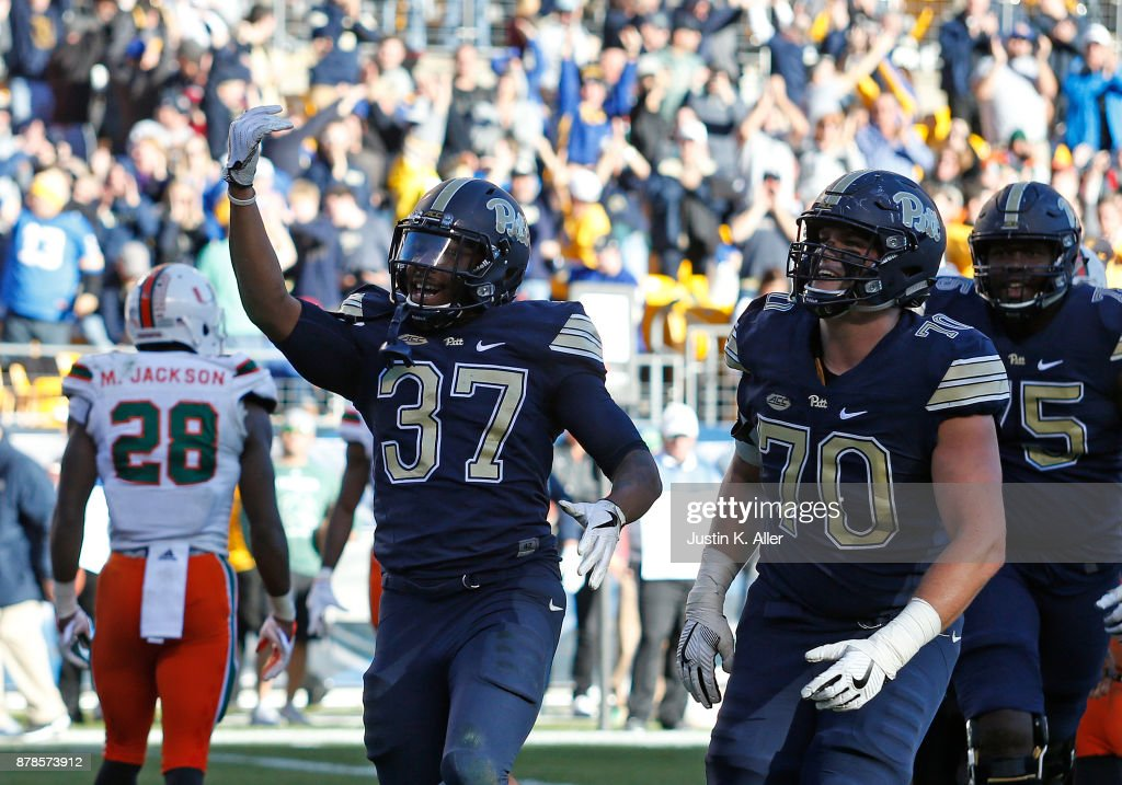 Qadree Ollison #37 of the Pittsburgh Panthers celebrates his 5 yard rushing touchdown in the second half on November 24, 2017 at Heinz Field in Pittsburgh, Pennsylvania.