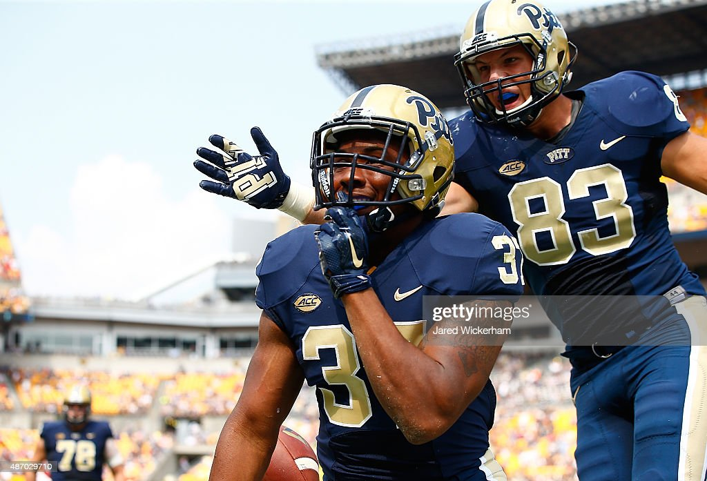 Qadree Ollison #37 of the Pittsburgh Panthers reacts with teammate Scott Orndoff #83 following a long run in the second half against the Youngstown State Penguins during the game at Heinz Field on September 5, 2015 in Pittsburgh, Pennsylvania.