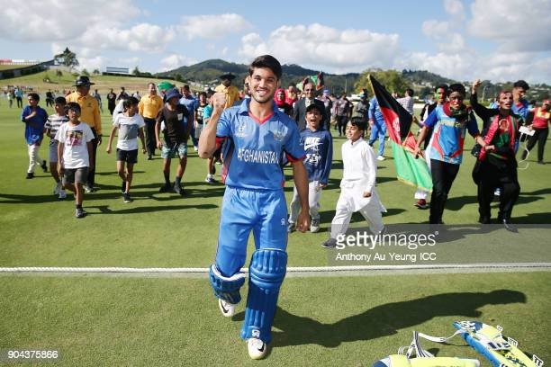 Qais Ahmad of Afghanistan celebrates with the fans after winning the ICC U19 Cricket World Cup match between Pakistan and Afghanistan at Cobham Oval...