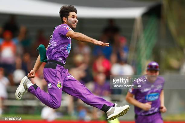 Qais Ahmad of the Hurricanes celebrates after dismissing Ben Dwarshuis of the Sixers during the Big Bash League match between the Hobart Hurricanes...