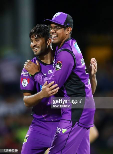 Qais Ahmad of the Hurricanes celebrates with Clive Rose after dismissing Aaron Finch of the Renegades during the Hurricanes v Renegades Big Bash...